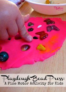 Playdough bead press a fine motor activity for kids.