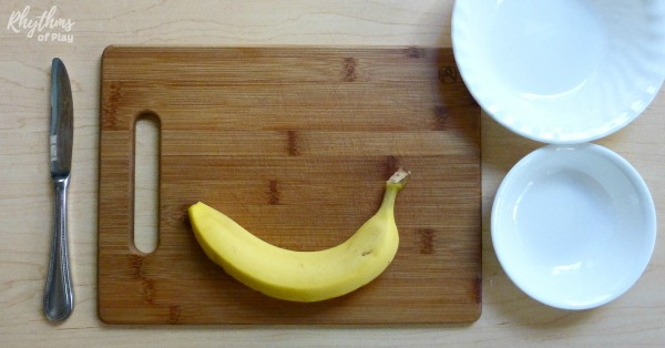 place banana cutting Montessori materials on the table as shown