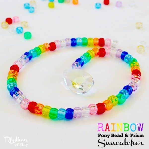Making a rainbow pony bead and prism suncatcher is a fun fine motor activity for kids and adults of all ages. Suncatchers made out of beads in a rainbow of colors are lovely home decor to hang in a window and enjoy. The prism will cast beautiful rainbows all over the room when the sun hits it. These would make a great decoration or favor idea for a rainbow party. This DIY craft project also makes a wonderful gift idea for Christmas, birthdays or any other occasion!