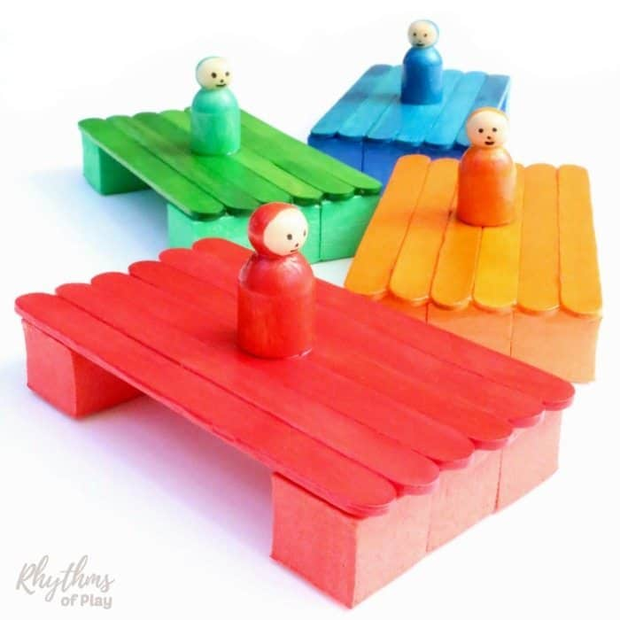 red blue green and orange craft stick boats