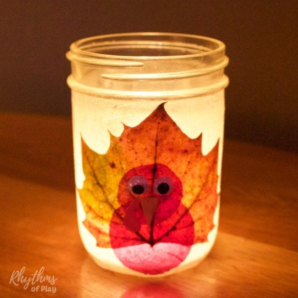 DIY turkey leaf lanterns are made with real fall leaves and mason jars.