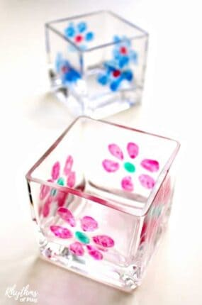 DIY flower painted votives are an easykid-made gift idea that even toddlers can make. Hand paintedcandle holders make a great homemade gift idea for friends and family.