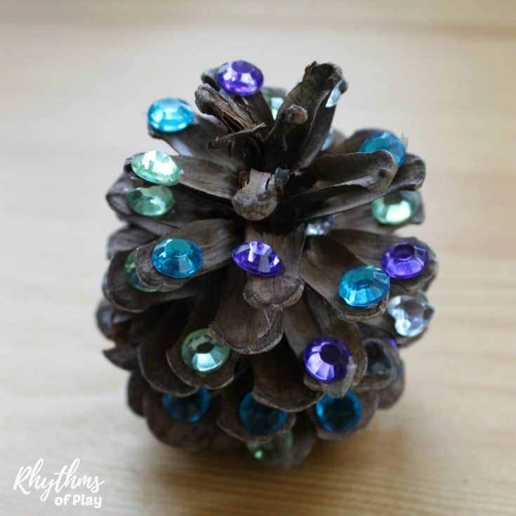 Add a little rustic bling to your Christmas decorations with these rhinestonepinecones! Making rhinestone pinecones is a fun fine motor activity for kids and an easy nature craft for adults. Once finished, they can be made into ornaments, used to make a pinecone garland or placed in a bowl and displayedas home decor for the holidays.