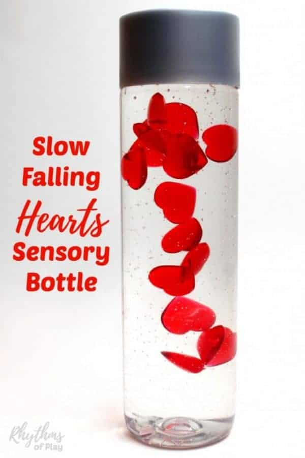 Slow falling hearts sensory bottle makes a great gift idea for Christmas, Valentine's Day, and anniversaries. Discovery bottles like this are commonly used for no mess sensory play, as a calm down jar, or a meditation technique for children. They are just as effective for adults. #sensoryplay #sensory #heart #valentine #valentinesday #valentinesdaygiftideas #gifts #sensorybottle #giftideas