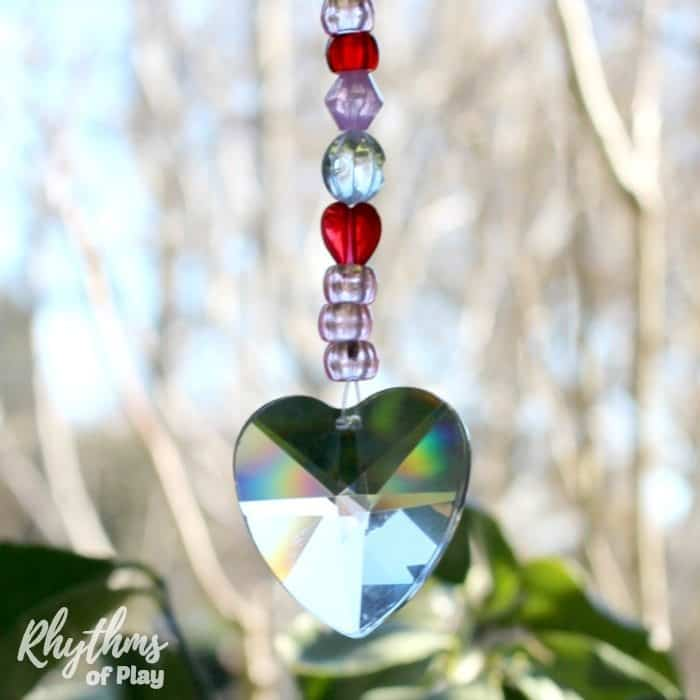 DIY Gift idea for Valentine's day! Making a heart prism pony bead suncatcher is an easy fine motor craft for preschoolers, kids, and adults. It would also make a wonderful gift idea for anniversaries, Mother's Day, Father's Day, Christmas, birthdays, or any other special occasion!