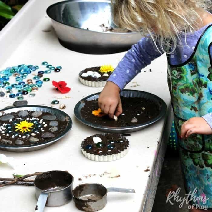 DIY outdoor art table and mud pie kitchen for backyard play and homeschool projects. We use our backyard mud kitchen for projects of all kinds includingarts, crafts, mud pies, gardening, STEAM projects, nature study, sensory activities, and even Montessori practical life activities!