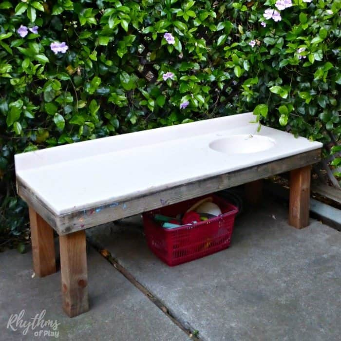 diy outdoor art table and mud pie kitchen for backyard play and