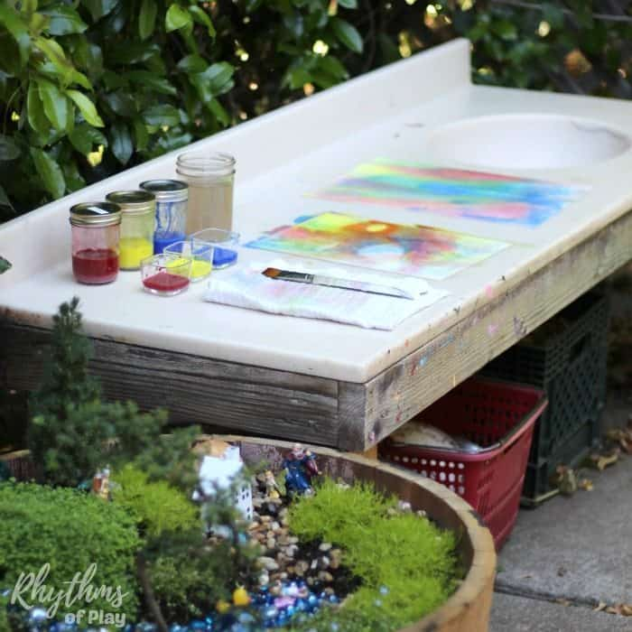 DIY outdoor art table and mud pie kitchen for backyard play and homeschool projects. We use our backyard mud kitchen for projects of all kinds.