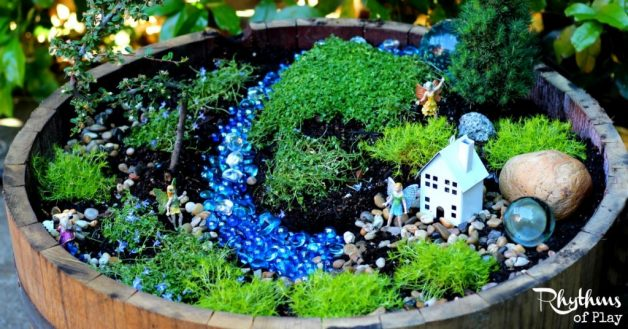Learn how to start your own fairy garden using these easy tips and tricks! Miniature gardens like this fairy garden are a lovely addition to any porch, deck, backyard, or garden. They also make magical small worlds for kids that are perfect for pretend play. How to Start a Fairy Garden | How to Make a Fairy Garden | How to create a fairy garden | DIY Fairy Garden | Small World | Imaginative Play