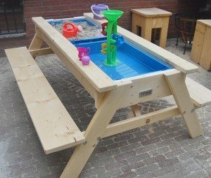picnic table with sand and water