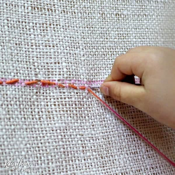 how to teach children to sew a running stitch.