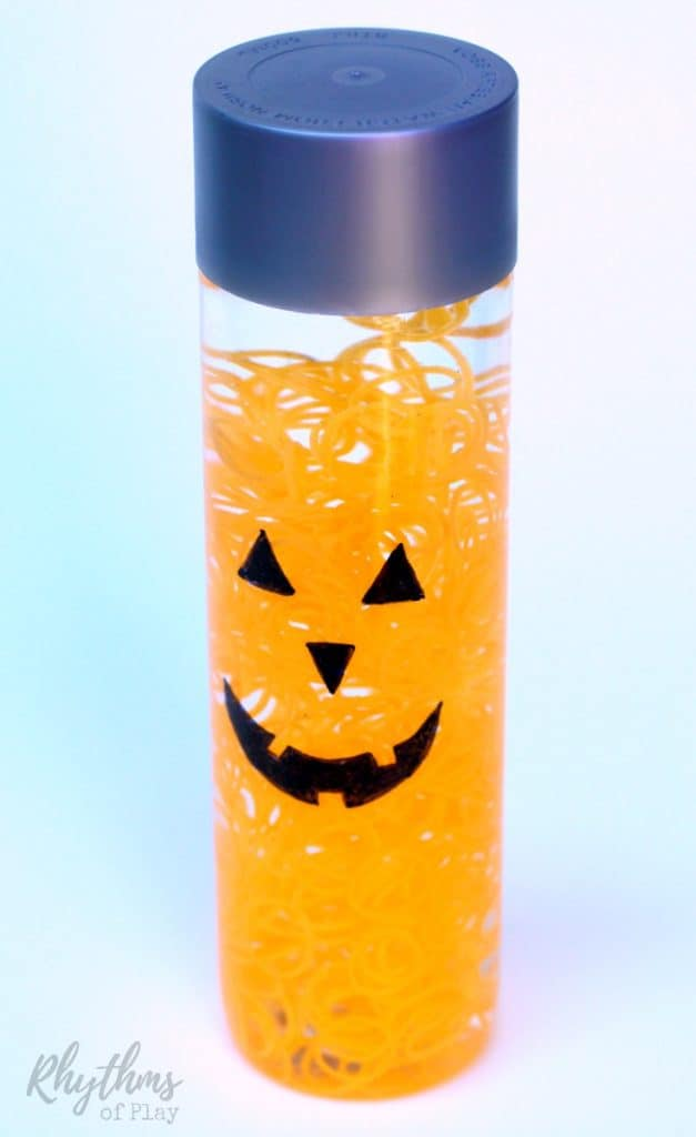 This calm down jar would make an easy decoration for Halloween parties and on Halloween night. Calm down sensory bottles like this DIY glow in the dark Halloween pumpkin sensory bottle are commonly used for safe no mess sensory play, a time out tool, and to help children (and adults) calm down and unwind. Discovery bottles are also the perfect way for babies and toddlers to safely investigate small items without the risk of choking on them.