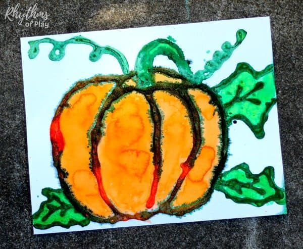 This harvest pumpkin watercolor art project is an easy painting idea for kids and adults. Kids from preschool age and up will enjoy the salt painting technique used to create this raised watercolor fall decoration. Click through to learn how to make your own DIY autumn home decor!