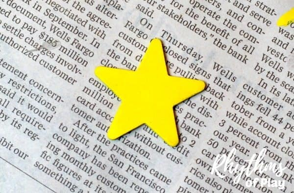 Wooden star painted yellow for Christmas nativity stable