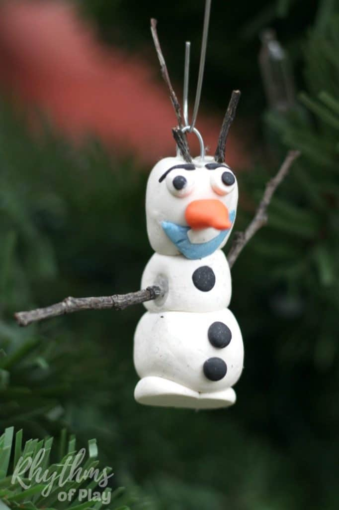Making a homemade DIY Olaf ornament is an easy Christmas craft for kids inspired by Disney's Frozen. Handmade ornaments like this polymer clay Olaf ornament are perfect for the Christmas tree. They make beautiful holiday decorations and a great kid-made gift idea!
