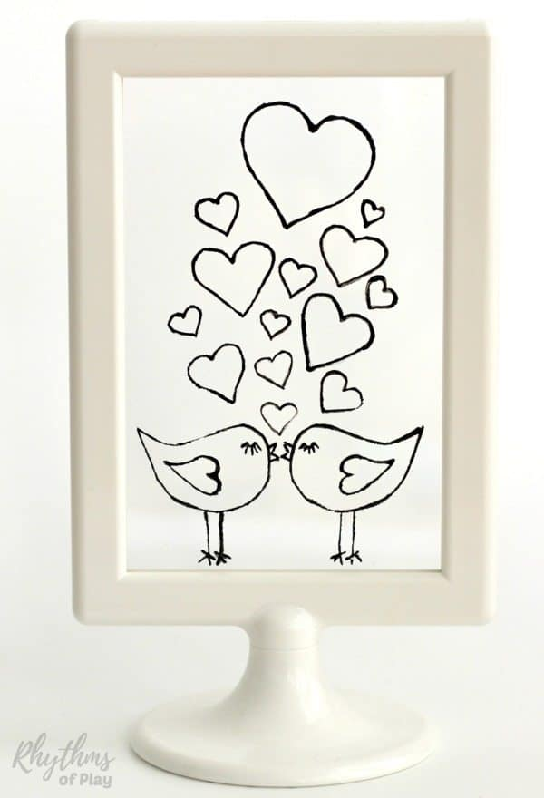 These DIY hand painted stained glass love birds would make a great homemade gift idea for Valentine's Day, weddings, and anniversaries. Click through to download the free printable template and learn how easy it is to create stained glass art windows and suncatchers using glass paint. Anyone that can trace, draw or illustrate can do this easy art project.