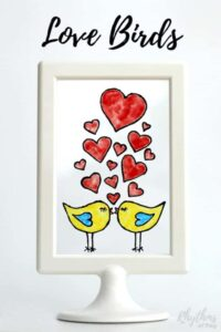 These DIY hand painted stained glass love birds would make a great homemade gift idea for Valentine's Day, weddings, and anniversaries. Click through to download the free printable template and learn how easy it is to create stained glass art windows and suncatchers using glass paint. If you like to color you will love this! Anyone that can trace, draw or illustrate can do this easy art project.