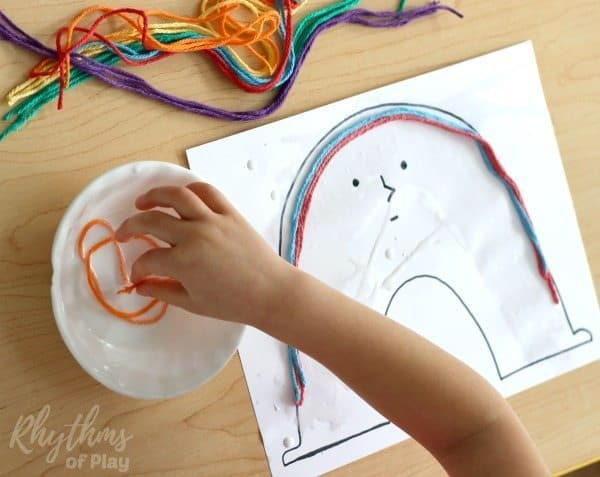 Rainbow yarn art book activity for kids process