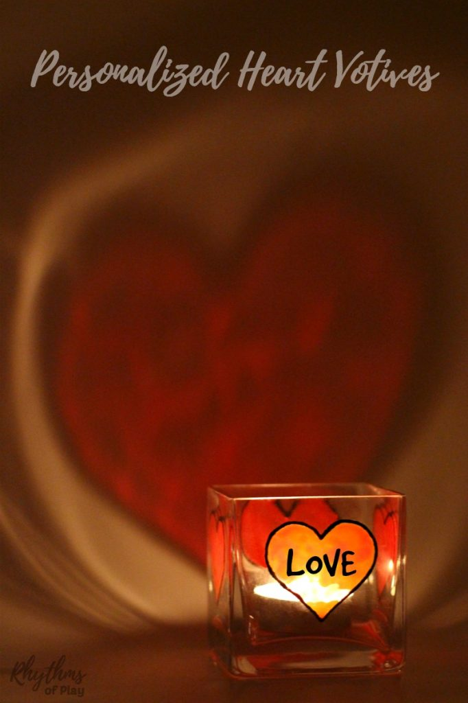 DIY Personalized gift ideas are always a favorite with friends and family! Creating gorgeous stained glass heart art decorations with glass paint on square votive candle holders is an easy craft for older kids, teens, and adults. These DIY personalized heart votive candle holders make a beautiful wedding centerpiece or gift idea for Valentine's Day, Mother's day, Father's Day and anniversaries.