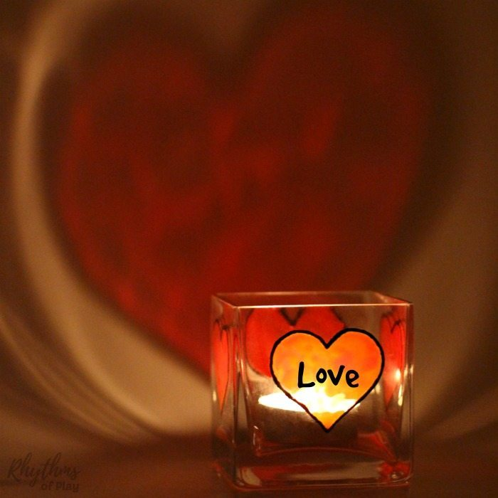 Glass paint heart with the word love written in it painted on a square votive candle holder