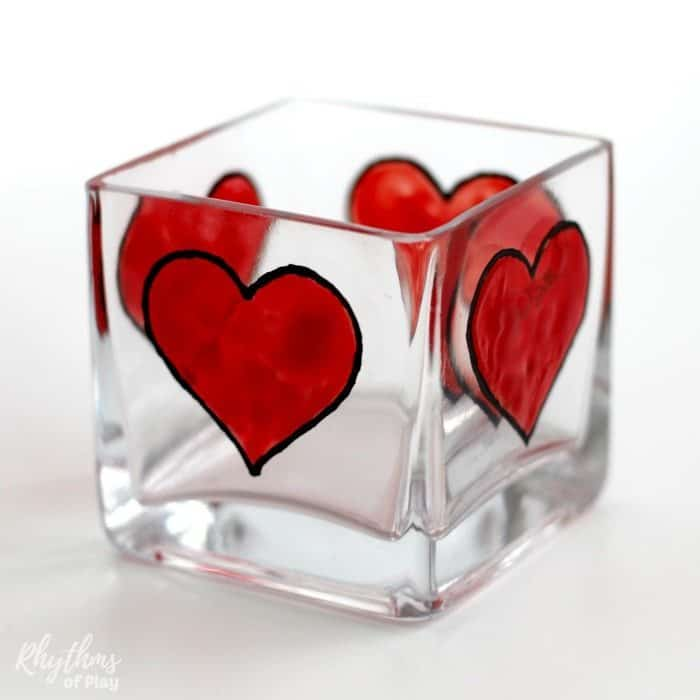 4 hearts painted on a square votive candle holder