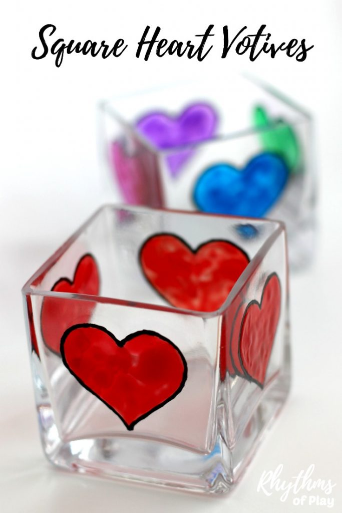 Creating gorgeous stained glass heart decorations with glass paint on a square votive candle holder is easy for older kids, teens, and adults. Anyone that can draw or trace can do this easy art project. These DIY quadruple heart votive candle holders make a beautiful wedding centerpiece or gift idea for Valentine's Day, Mother's day, Father's Day and anniversaries. You can even personalize them!