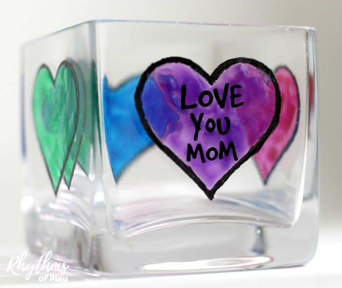 DIY Mother's Day Personalized Votive Candle Holder Gift Idea - Mom's love personalized homemade keepsake gifts for Mother's Day! Creating gorgeous stained glass hearts on votive candle holders and personalizing them for mom, nana, or grandma is fun and easy for both kids and adults. Anyone that can draw or trace can do this easy handmade art project.