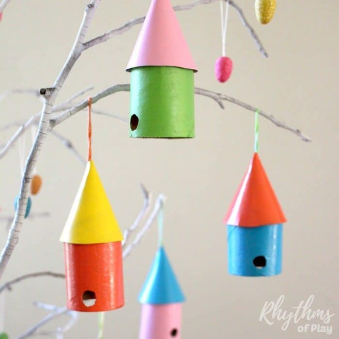 Make DIY upcycled birdhouse ornaments out of recycled materials. Grab some cardboard toilet roll tubes and boxes from your recycle bin and make some cute birdhouses. An easy craft idea for kids! Perfect for spring trees, Easter trees, garlands, and spring home decor. Making these would also be a great complement to a bird study unit for Homeschoolers.