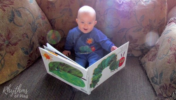 "baby reading ""The Very Hungry Caterpillar"""