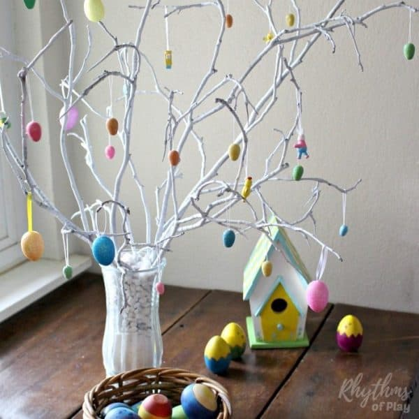 Spring easter egg tree on table with easter ornaments