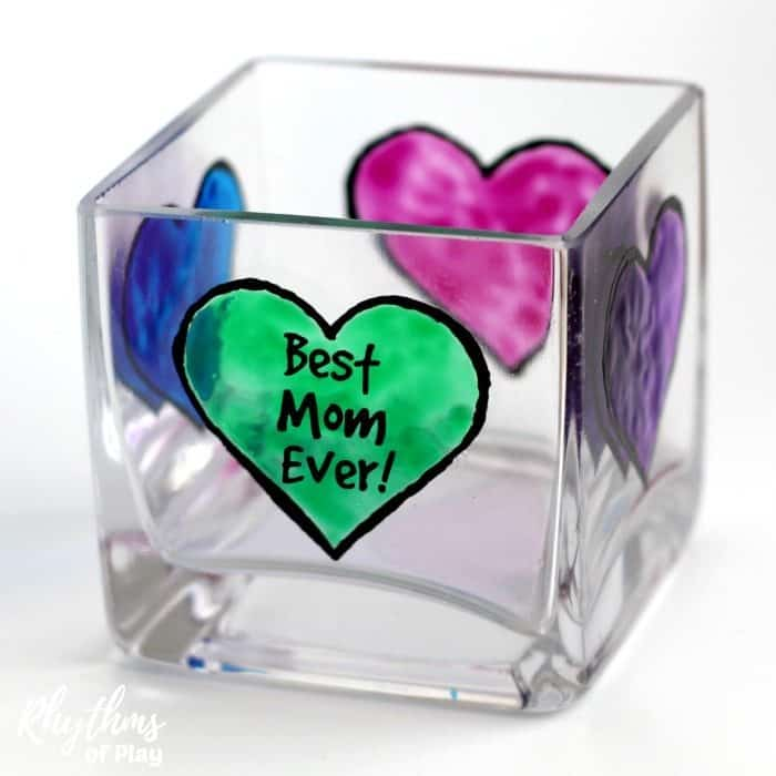 DIY Mother's Day personalized votive candle holder gift idea - Mom's love personalized homemade keepsake gifts for Mother's Day!Creating gorgeous stained glass hearts on votive candle holders and personalizing them for mom, nana, or grandma is fun and easy for both kids and adults. Anyone that can draw or trace can do this easy handmade art project.