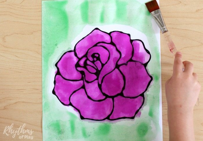 Black glue rose watercolor resist art project. A fun and easy spring and summer flower painting idea for kids, teens, and adults. The tutorial includes how to make black glue and basic beginning watercolor techniques to use for inspiration. Makes a simple and beautiful Mother's day gift idea!