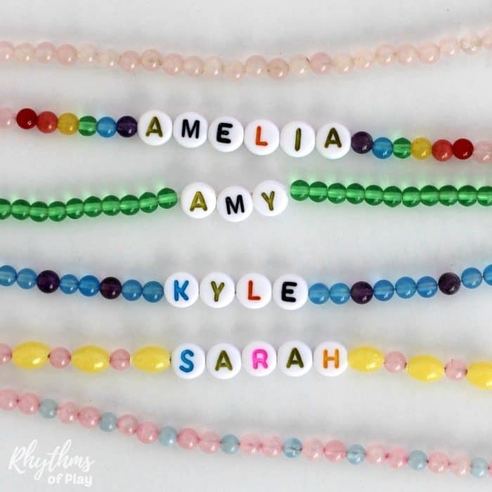 DIY beaded name necklace literacy activity for young children - Have your child learn to recognize and spell their name while making beautiful jewelry they can wear! Stringing beads is a fine motor activity that will help children strengthen the fine motor muscles in their hands to prepare for writing. Older children and teens that already know how to read and write can have fun learning to make their own personalized jewelry. Personalized name necklaces and bracelets also make a great gift idea for friends and family.
