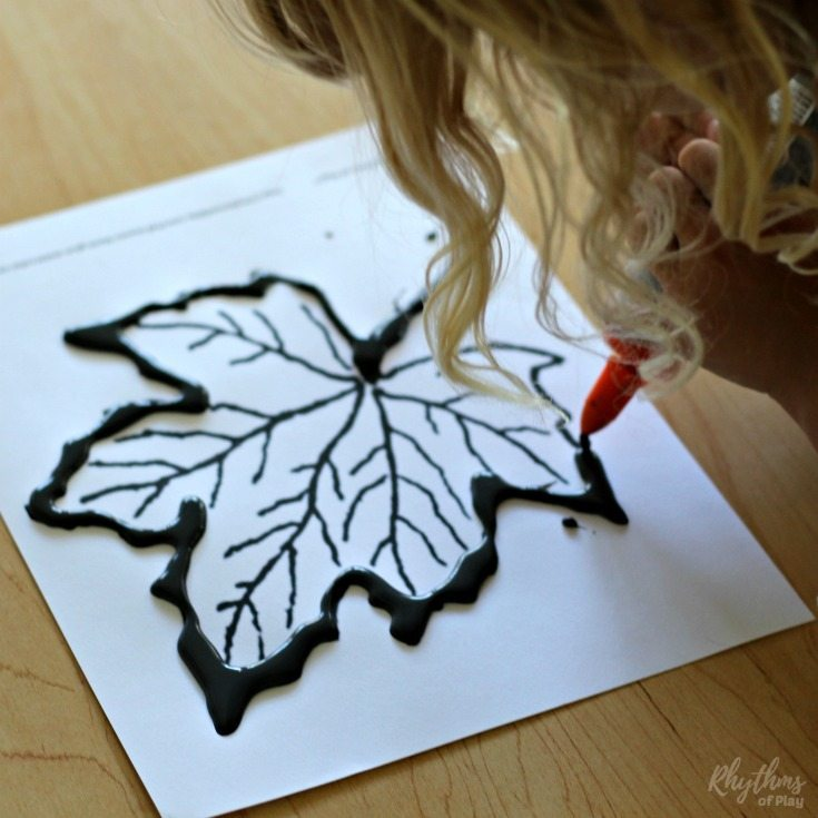 Create beautiful fall leaves art with black glue and watercolors. Painting maple, oak, and beech leaves using black glue as a resist medium is an easy autumn art project for kids and adults. Includes FREE fall leaf templates!