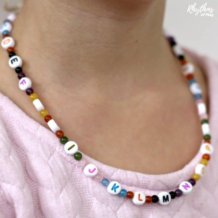 Alphabet bead necklace craft for kids. A literacy and fine motoractivity for children. Makes a unique handmade DIY gift idea kids can make! #craft #necklace #literacy