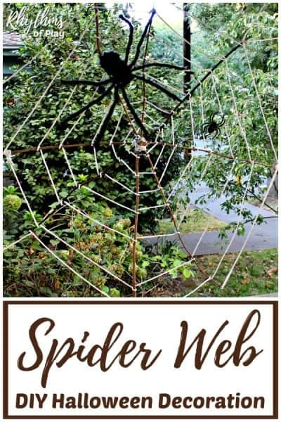 DIY Halloween spider web decoration made with bare branches.