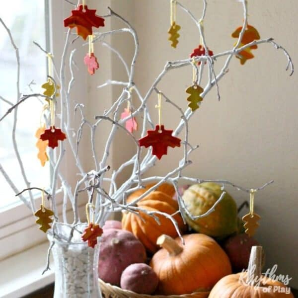 Thanksgiving thankful tree in window with gratitude leaves hanging on it.