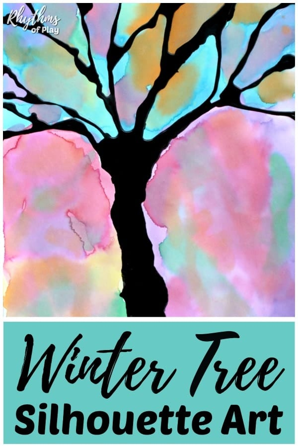 winter tree silhouette art project made with black glue and watercolor