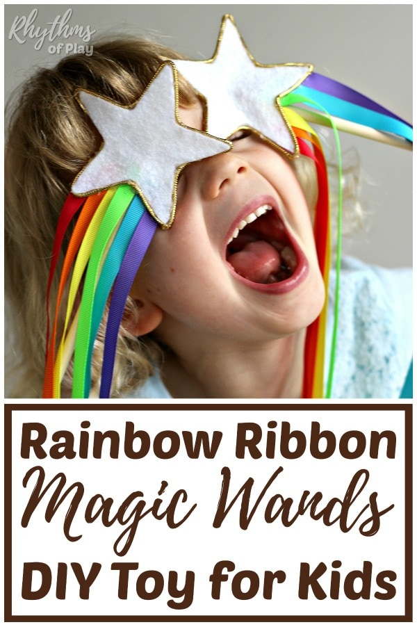 Homemade magic wand for kids made with a felt star and rainbow ribbon streamers.