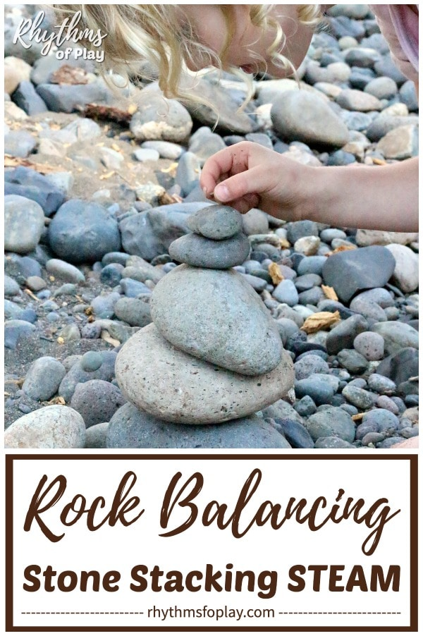 child creating rock balancing art