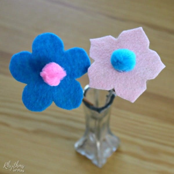Pink and blue felt flowers in a vase