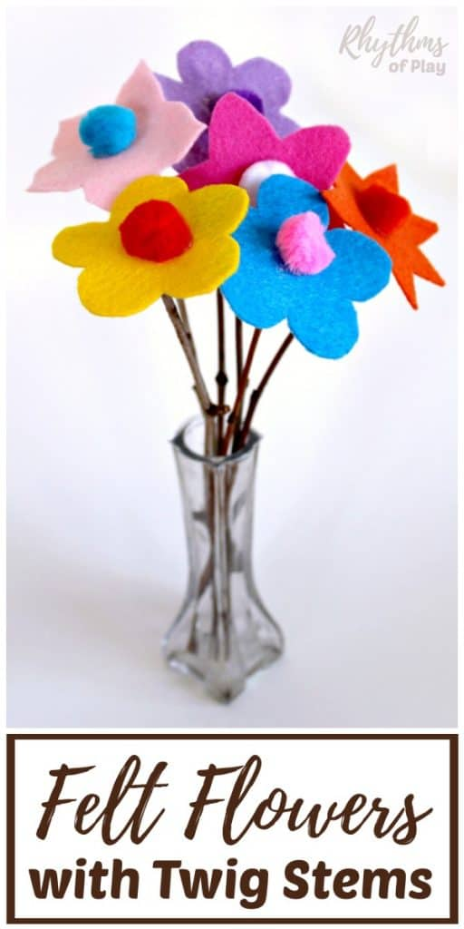 Colorful felt flowers with twigs in a vase