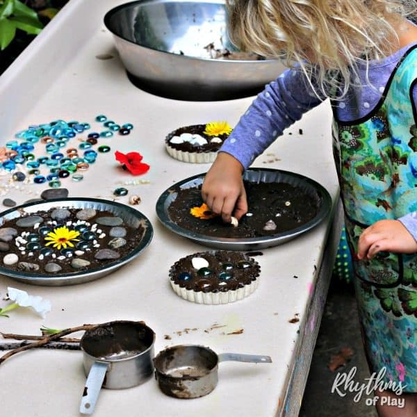 Child making mud pies in a mud kitchen