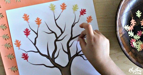 fall tree craft - child making fall leaf collage art