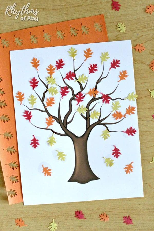 Fall tree craft - place construction paper leaves on a bare fall tree to make this fall art collage