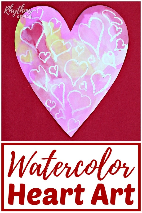 heart shaped watercolor painting with small hearts made with white pastel.