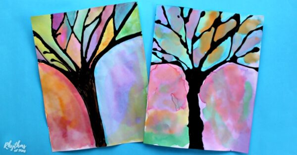 Winter tree silhouette art painted with watercolors and black glue as the resist medium