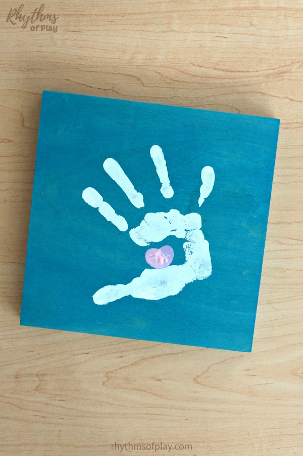 handprint art craft with thumbprint heart inside hand