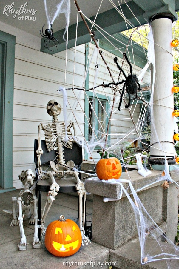 Halloween decoration outdoor - spider web and skeleton Halloween porch decor