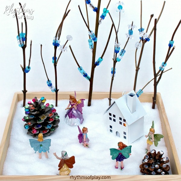 Winter fairy garden with pony bead trees and Epsom salt snow instead of plants and soil.
